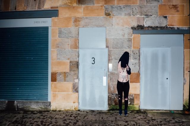 Heather posing topless outside Many Studios in Glasgow by Lee Jones