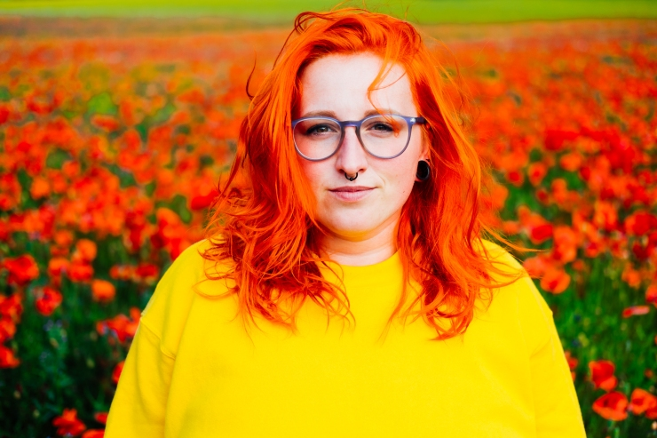 Robyn in poppy field in North Yorkshire by photographer Lee Jones